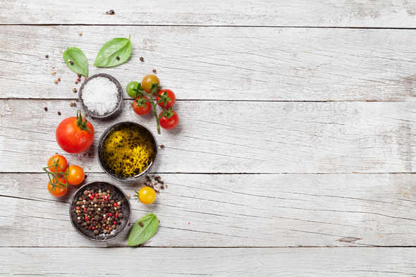 Tomatoes, basil, olive oil and spices - Stock Photo - Images