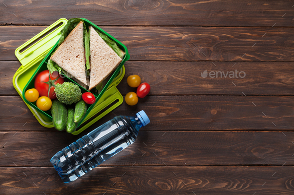 Lunch box with vegetables and sandwich - Stock Photo - Images