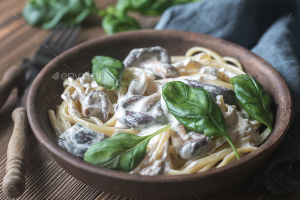Portion of creamy mushroom linguine - Stock Photo - Images