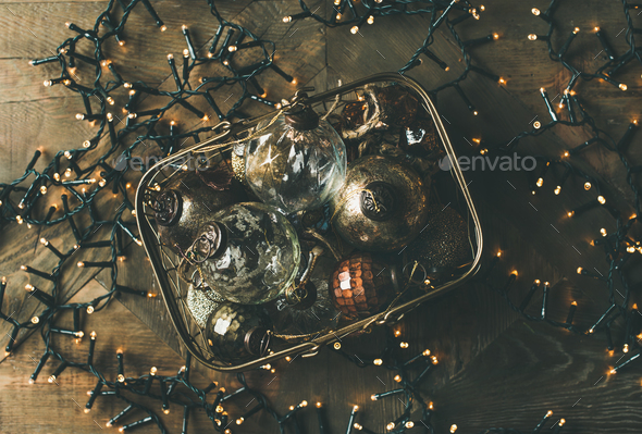 Christmas decoration balls in box and holiday light garland - Stock Photo - Images