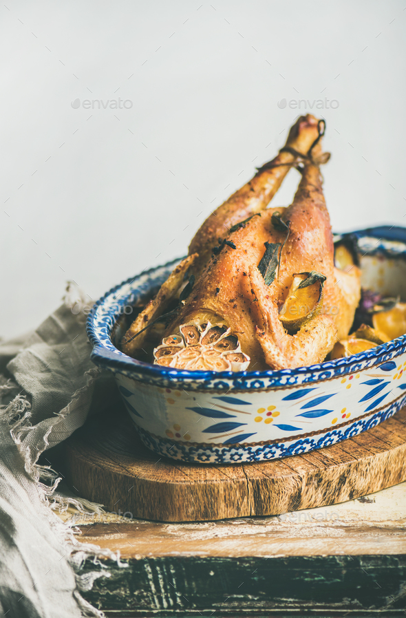 Roasted whole chicken with garlic and oranges for Christmas - Stock Photo - Images