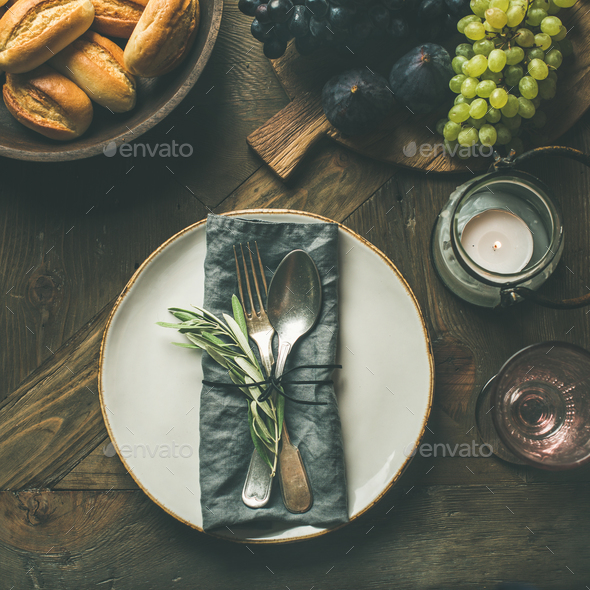 Fall table decoration setting with cutlery and snacks, copy space - Stock Photo - Images