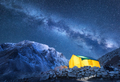 Milky Way, yellow glowing tent and mountains - PhotoDune Item for Sale