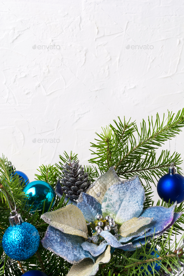 Christmas background with silver beads, blue silk poinsettias, c - Stock Photo - Images