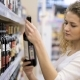 Beautiful Woman Chooses and Buying Wine In The Supermarket - VideoHive Item for Sale