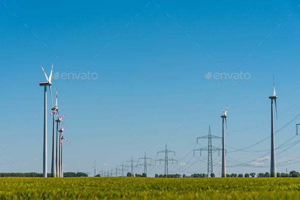 Wind power plants and power transmission lines - Stock Photo - Images