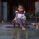 Little Cute Little Girl Is Sitting on a Chair - VideoHive Item for Sale
