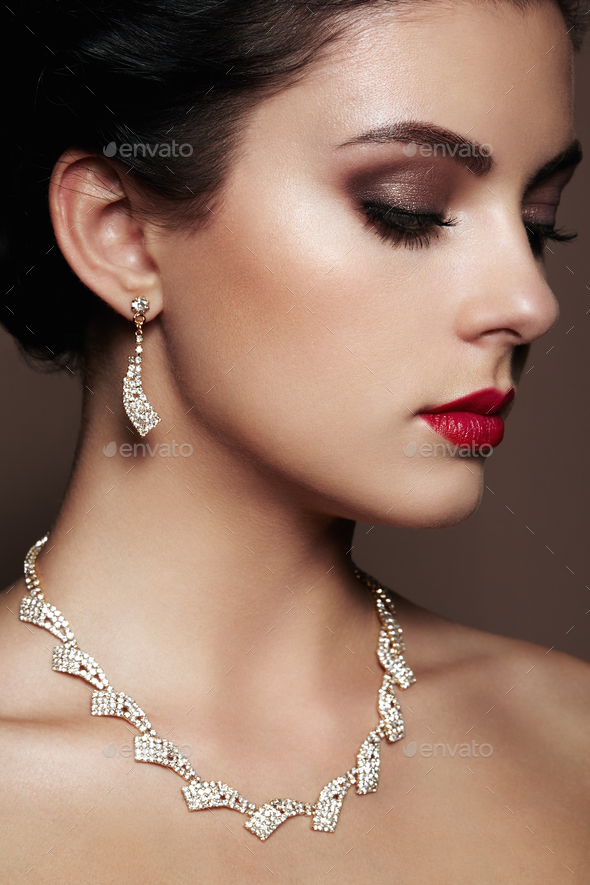 Fashion portrait of young beautiful woman with jewelry. - Stock Photo - Images