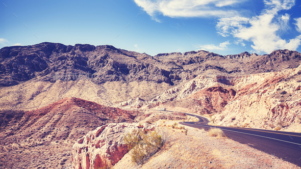 Vintage toned pictue of a desert road in Valley of Fire, USA. - Stock Photo - Images