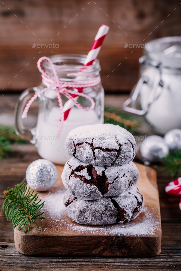 Chocolate crinkle cookies with powdered sugar icing for christmas - Stock Photo - Images