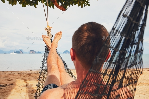Man relaxing in the hammock - Stock Photo - Images