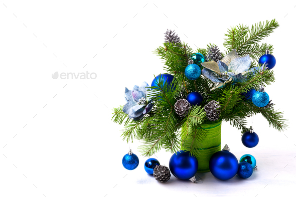 Christmas arrangement silk poinsettias, blue baubles, copy space - Stock Photo - Images