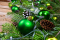 Christmas decoration with green balls, fir cones and silver ribb - PhotoDune Item for Sale