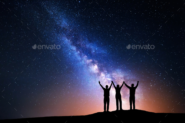 Landscape with Milky Way and silhouette of a happy family - Stock Photo - Images