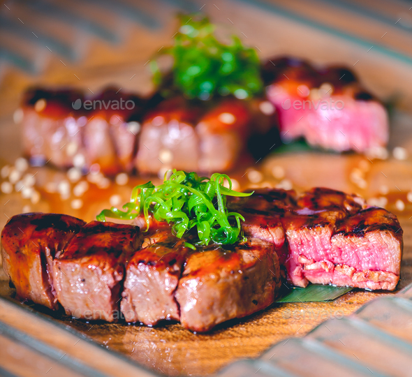 Grilled steaks with herbs - Stock Photo - Images