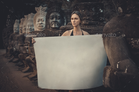 Young woman holding paper - Stock Photo - Images