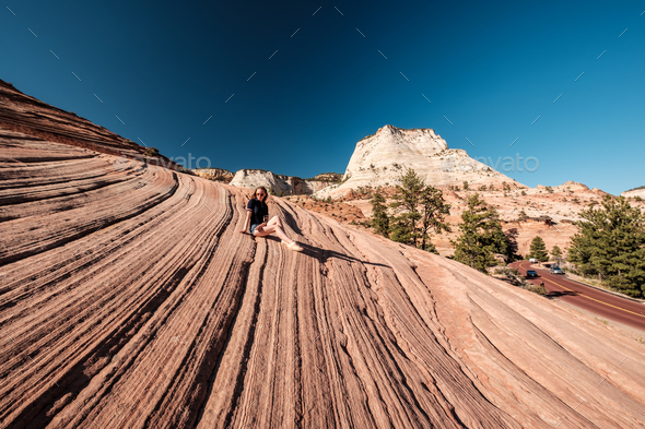Woman sitting on rock formation in Utah, USA - Stock Photo - Images
