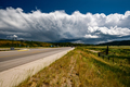 Empty open highway and stormy clouds in Wyoming - PhotoDune Item for Sale