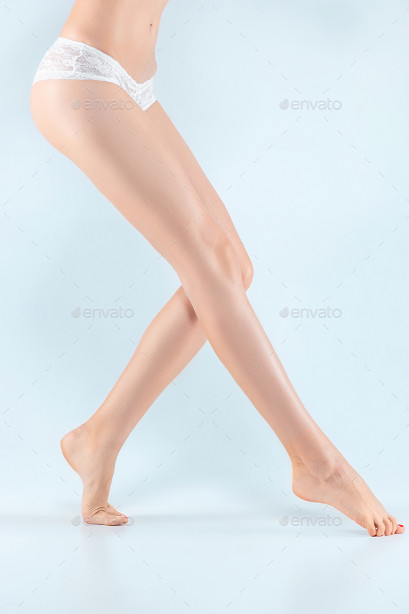 Perfect female legs in underwear. - Stock Photo - Images