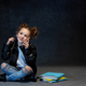Little girl sitting with smartphone in studio - PhotoDune Item for Sale