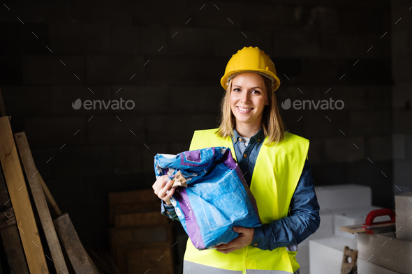 Young woman worker in a warehouse. - Stock Photo - Images
