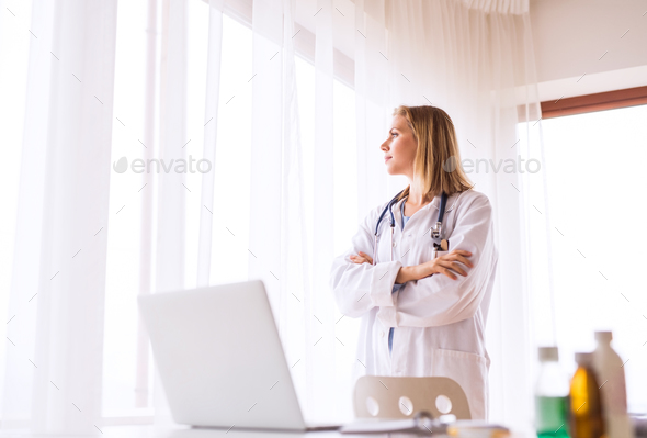 Portrait of a young female doctor. - Stock Photo - Images