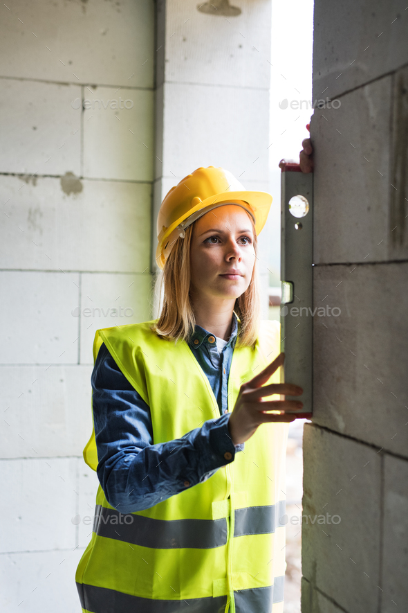 Young woman worker on the building site. - Stock Photo - Images