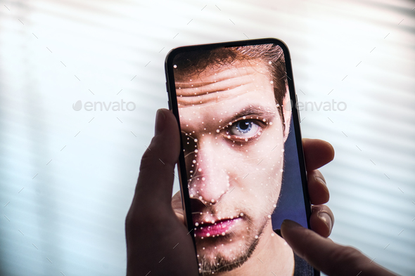 A smartphone using face ID recognition system. - Stock Photo - Images