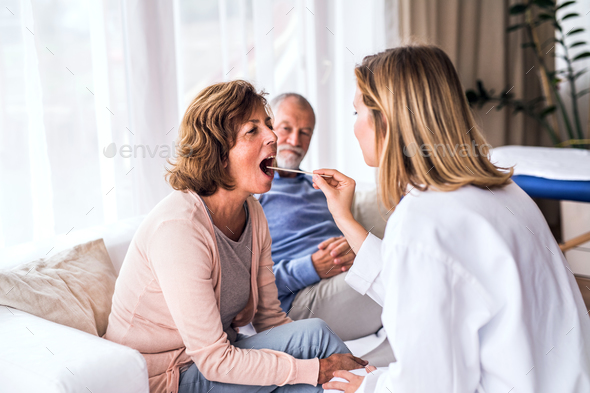 Female doctor examining a senior woman. - Stock Photo - Images