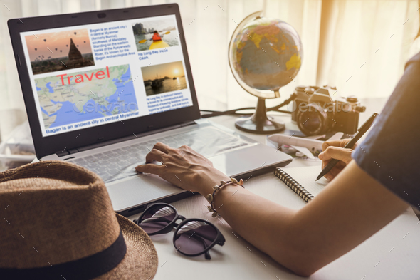 Young women planning vacation trip and searching information - Stock Photo - Images