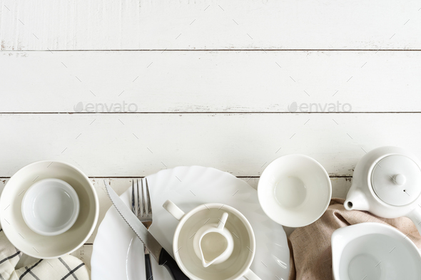 White empty dishes on wooden table with copy space - Stock Photo - Images