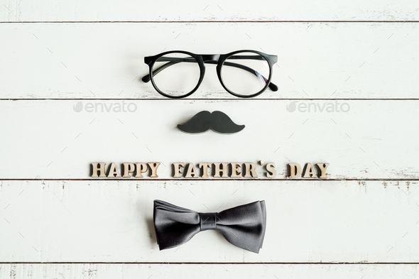 Happy Father's Day wooden letters with glasses and mustache - Stock Photo - Images