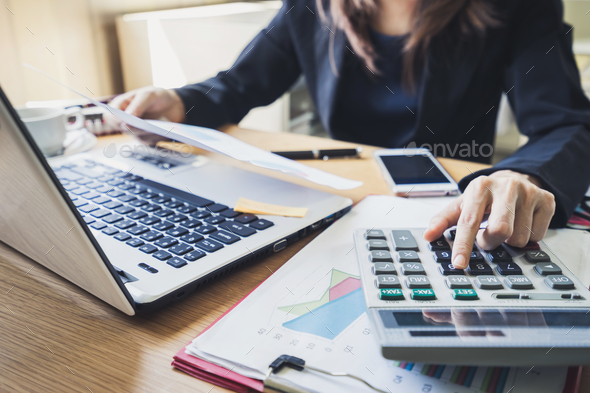 Businessman working on Desk office business financial accounting calculate - Stock Photo - Images