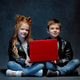 Studio shot of two children with laptop - PhotoDune Item for Sale