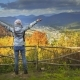 Young Woman Raising Hands on Mountain View Point - VideoHive Item for Sale