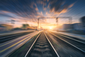 Railway station with motion blur effect. Blurred railroad - PhotoDune Item for Sale
