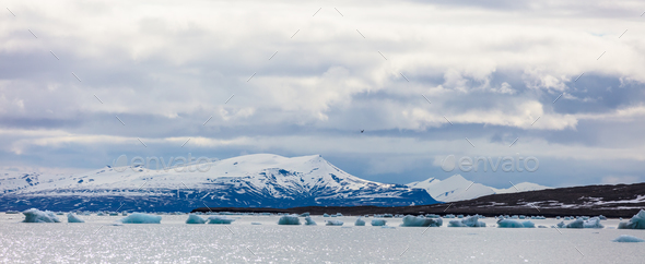 Panorama of floating sea ice in front of snowy mountains in the arctic - Stock Photo - Images