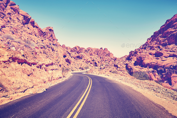 Retro stylized deserted canyon road, Nevada, USA. - Stock Photo - Images
