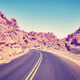 Retro stylized deserted canyon road, Nevada, USA. - PhotoDune Item for Sale