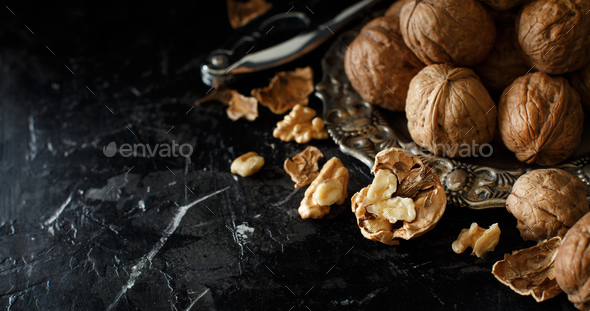 Fresh walnuts on a dark background - Stock Photo - Images