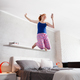 Good News For Happy Young Woman Girl Jumping On Bed - PhotoDune Item for Sale