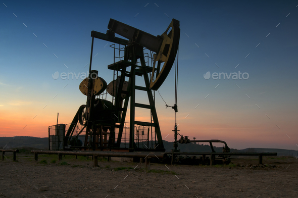 oil pump on sunset - Stock Photo - Images