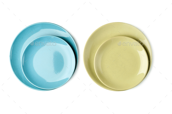 Green and blue plates on a white background. Isolated. - Stock Photo - Images