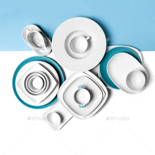 White and blue porcelain dishes on a white-blue background. - Stock Photo - Images