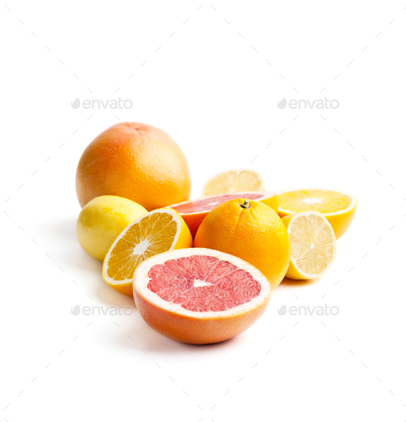 Grapefruits, oranges and lemons on a white background. Isolated. - Stock Photo - Images