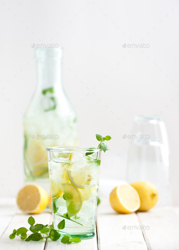Lemonade lemonade in a glass cup on a white wooden table. - Stock Photo - Images