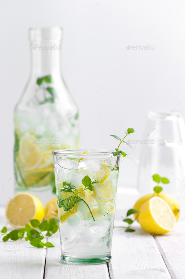 Lemonade in a glass cup on a white wooden table. - Stock Photo - Images