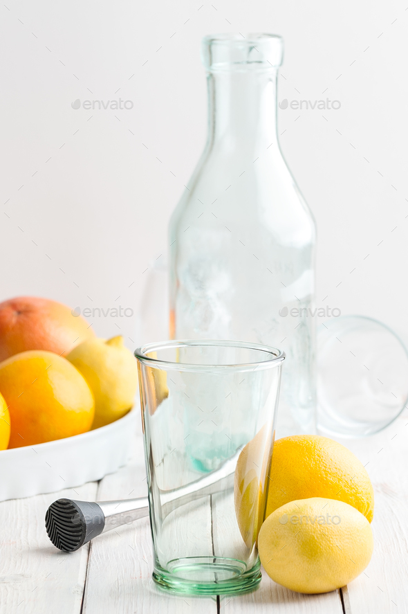 A set for making lemonade on a white wooden table. - Stock Photo - Images