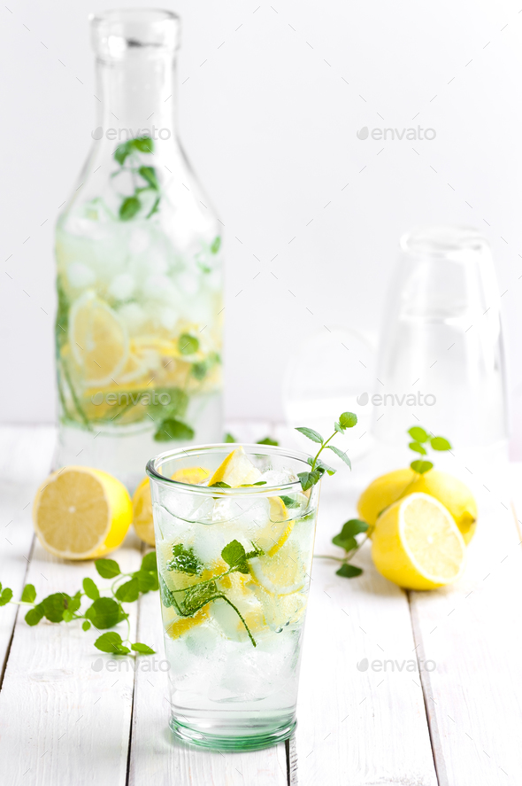 Citrus lemonade in a glass cup on a white wooden table. - Stock Photo - Images