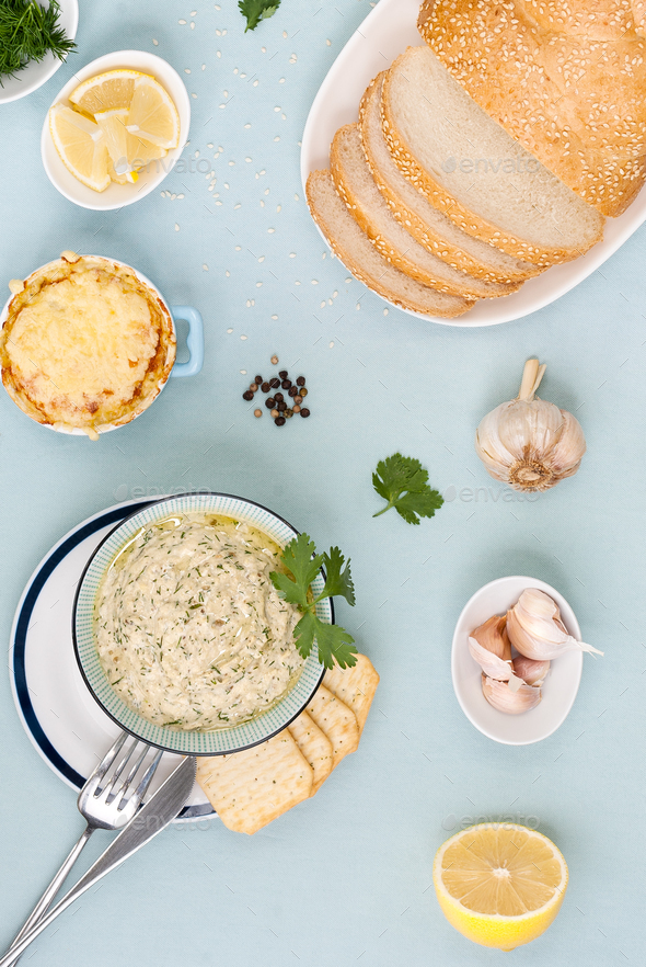 Pasta from eggplant and ingredients on a light blue pastel backg - Stock Photo - Images